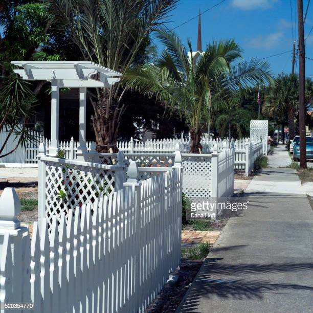 white picket fence and sidewalk - dana white stock pictures, royalty-free photos & images