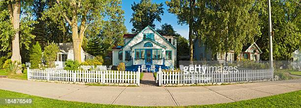 White picket fence idyllic wooden home garden panorama