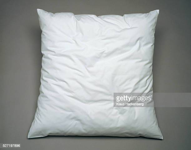 White pillow on general gray background