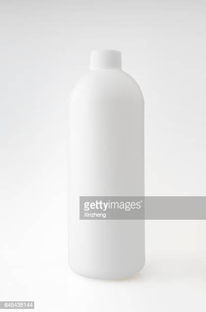 White Plastic Bottle Against White Background