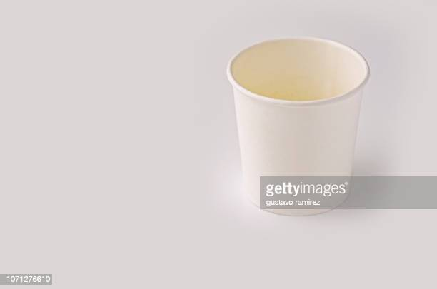 white plastic cup on white background