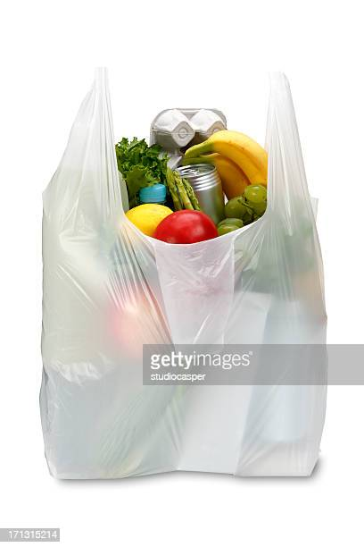 A white plastic grocery bag filled with produce