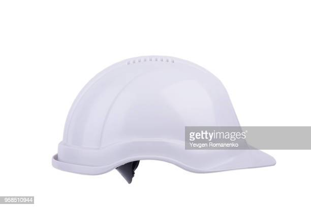 white plastic safety helmet, isolated on white background - schutzhelm stock-fotos und bilder