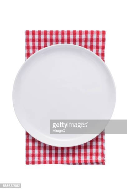 White Plate on Red Checked Pattern Tablecloth
