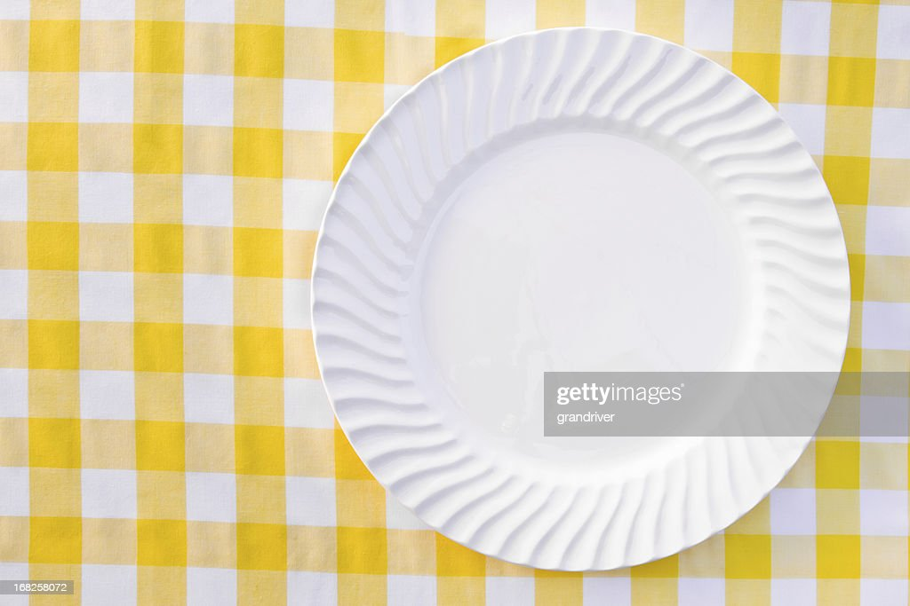 Exceptional White Plate On Yellow Checkered Tablecloth : Stock Photo