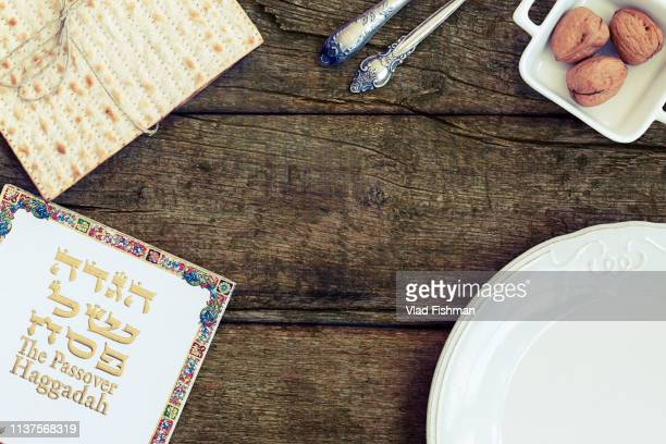 white plate with matzah or matza vintage wood table - happy passover stock pictures, royalty-free photos & images