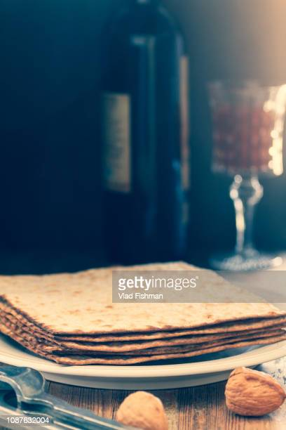 white plate with matzah - passover symbols stock pictures, royalty-free photos & images