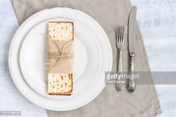 white plate with matzah - passover seder stock pictures, royalty-free photos & images