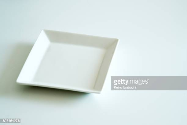 white plate with white background - 皿 ストックフォトと画像