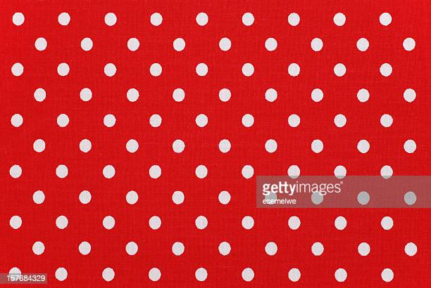 white polka dots on red fabric - spotted stock pictures, royalty-free photos & images