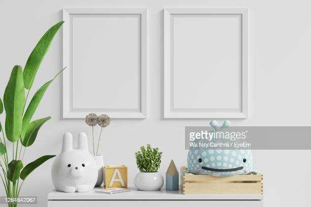 white potted plants on table against wall at home - nursery bedroom stock pictures, royalty-free photos & images