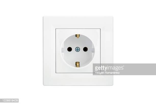 white power outlet isolated on white background - tomada - fotografias e filmes do acervo