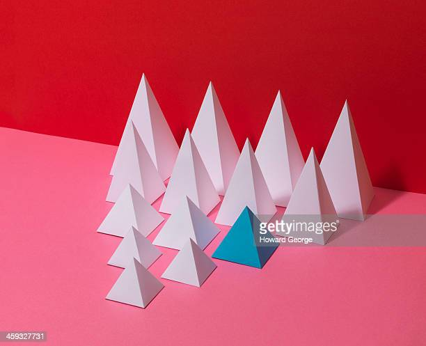 White Pyramids on Red Background