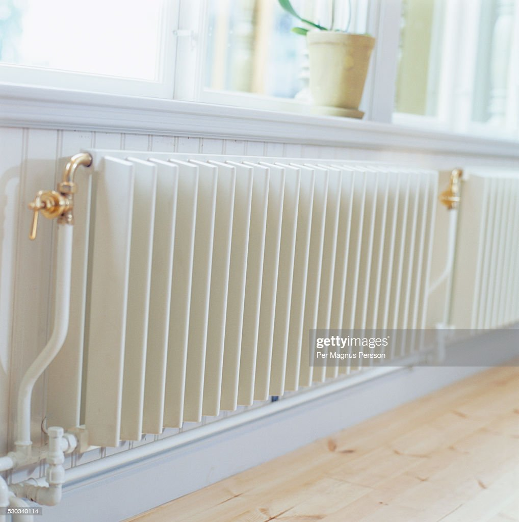 White Radiator Under Window Closeup High Res Stock Photo Getty Images