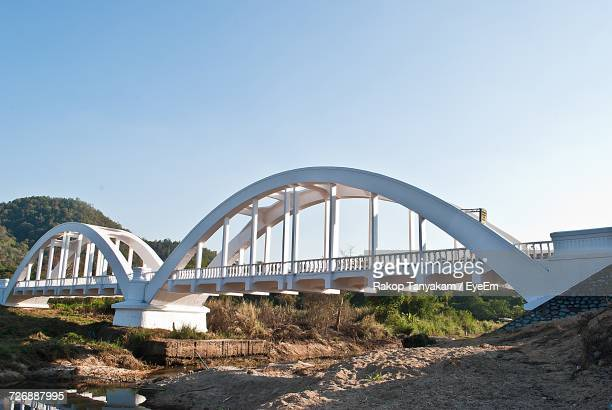 White Railway Bridge Over River Against Sky