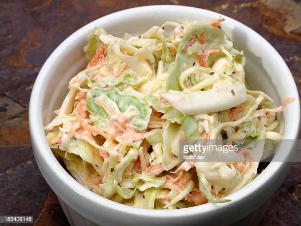 White ramekin of coleslaw on stone counter
