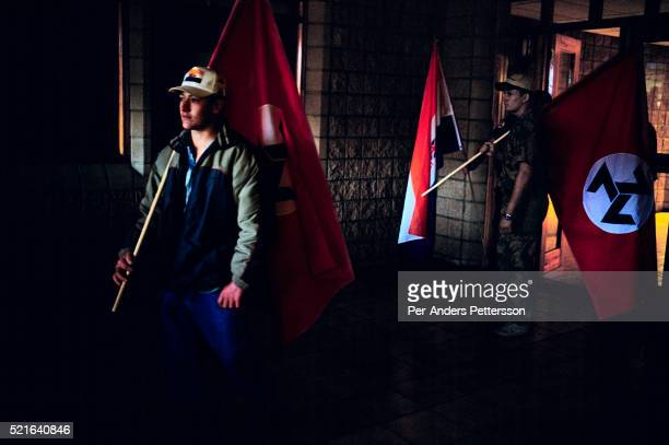 White right wing youth stand with their flags while waiting to demonstrate in the streets of Potchefstrom South Africa