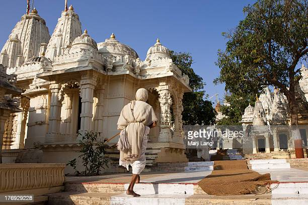 white robed nun climbing stairs in jain temple - palitana stock photos and pictures