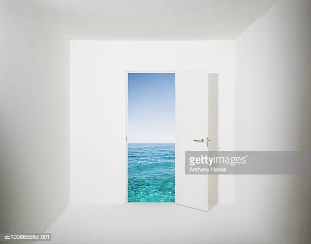 white room with aquamarine water and sky seen through open door (digital composite) - deur stockfoto's en -beelden