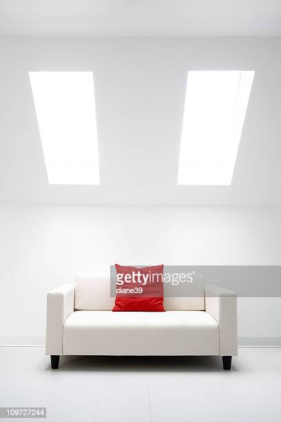 white room with red pillow
