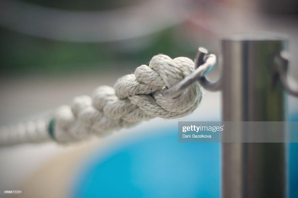 White rope surrounding the swimming pool : Stock Photo