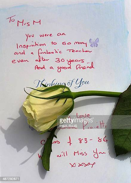 White rose is placed on a written tribute to murdered teacher Anne Maguire outside Corpus Christi Catholic College in Leeds, northern england, on...