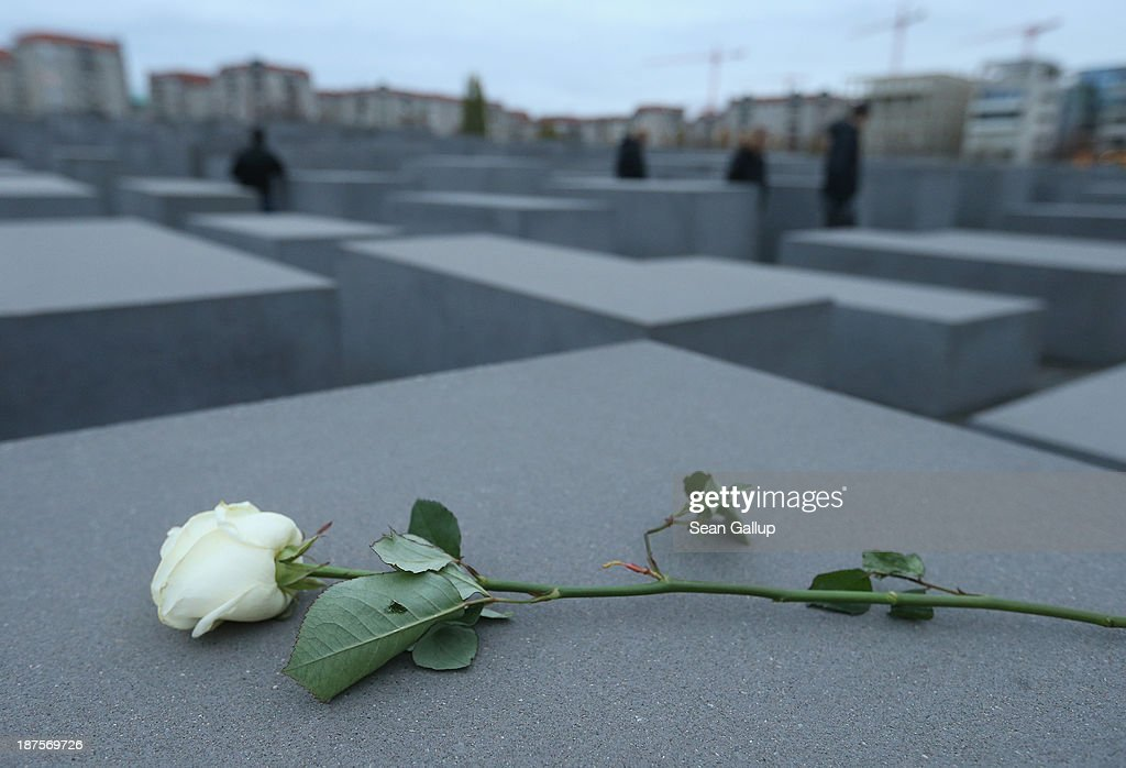 A white rose lies on one of the 2,711 stellae at the Memorial to the Murdered Jews of Europe, also called the Holocaust Memorial, on the 75th anniversary of the Kristallnacht pogroms on November 10, 2013 in Berlin, Germany. Events are taking place across the country to commemorate the day in 1938 when Nazi gangs across Germany and Austria burned down over 1,000 synagogues, smashed Jewish-owned businesses, looted Jewish residences and killed several hundred Jews. Anti-Semitism was a central component of Adolf Hitler's rise to power and won him wide-spread sympathy among ordinary Germans and Austrians.
