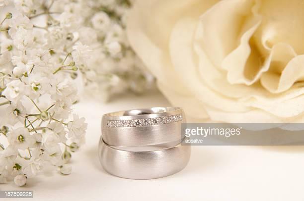 white rose, wedding ring and gypsophila