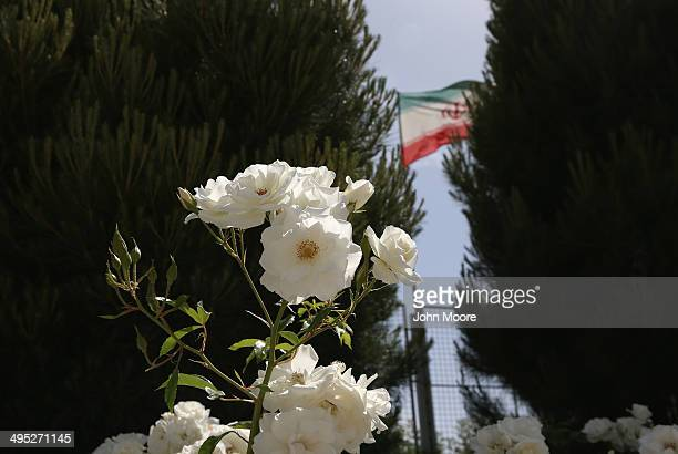 White roses and the Iranian flag stand near the tomb of Cyrus the Great on May 30 2014 in Pasargadae Iran The ruins mark the site of the first ruler...