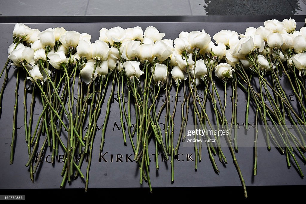 White roses lay at the memorial site after the 20th Anniversary Ceremony for the 1993 World Trade Center bombing at Ground Zero on February 26, 2013 in New York City. The attack, which utilized a car bomb and hit the north tower, killed six people.