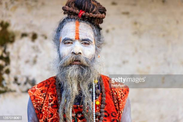 white sadhu - indian holyman sitting in the temple - hinduism stock pictures, royalty-free photos & images