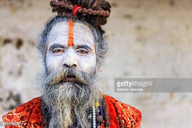 white sadhu - indian holyman sitting in the temple - varanasi stock pictures, royalty-free photos & images