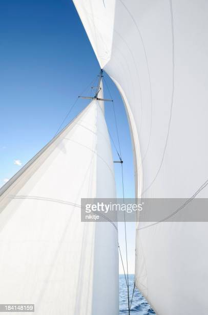 A white sail being blown by the wind
