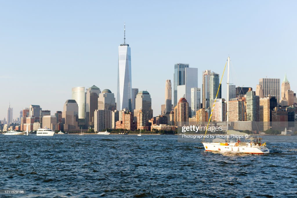 A white sailing boat enters the Hudson River in New York : Stock Photo
