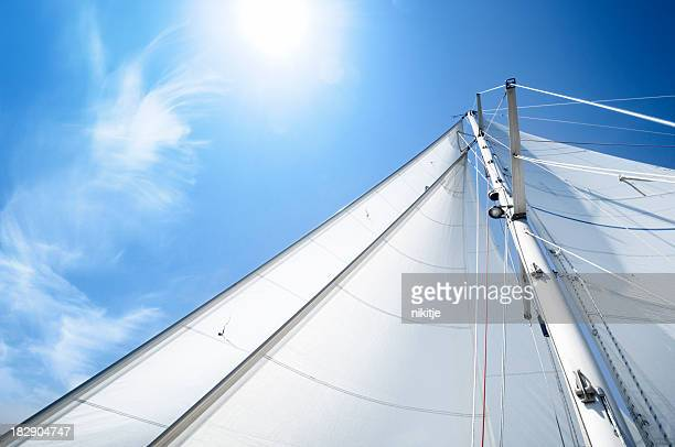 White sails of a yacht on sunny day