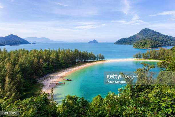 white sand beach and long-tail boat at kham-tok island (koh-kam-tok) - private stock photos and pictures