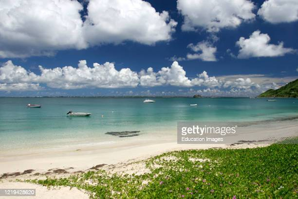 White sand beach at Grand Case St Martin with island of Anguilla in background.