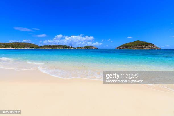White sand beach washed by turquoise caribbean sea, Half Moon Bay, Antigua and Barbuda,