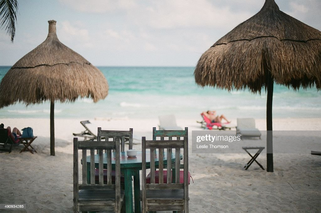 White Sand Beach With Table And Chairs