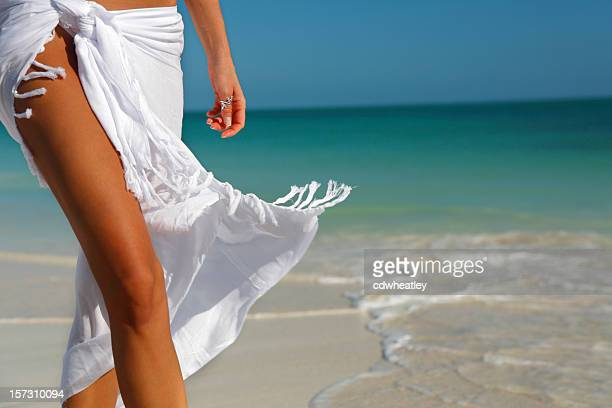 white sarong on beach - sarong stock photos and pictures