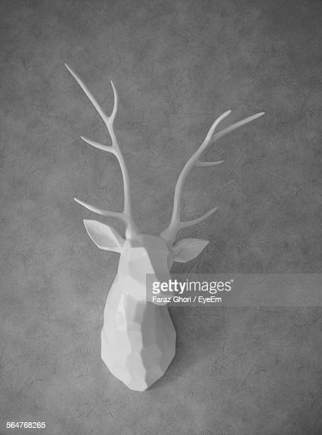 White Sculpture Of Deer On Wall