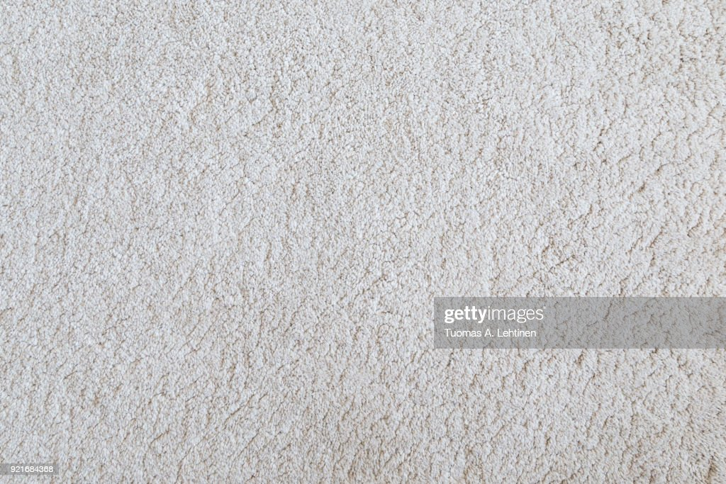 White shaggy carpet texture background viewed from above. : Foto de stock