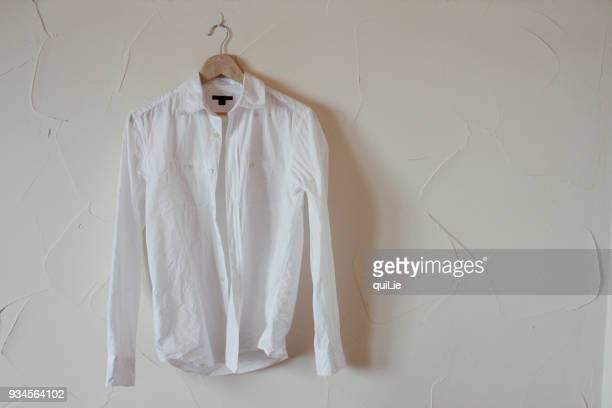 white shirt in white background - 白い服 ストックフォトと画像