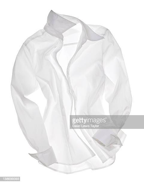 white shirt on light box - shirt stock pictures, royalty-free photos & images