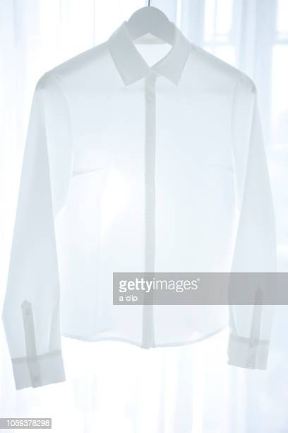 white shirt - blouse stock pictures, royalty-free photos & images
