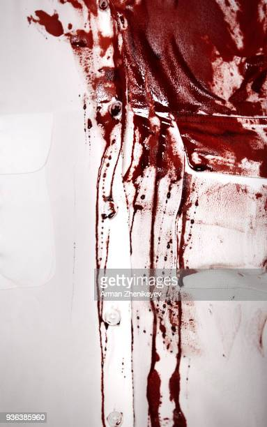 white shirt sopping with blood - blood photos stock pictures, royalty-free photos & images
