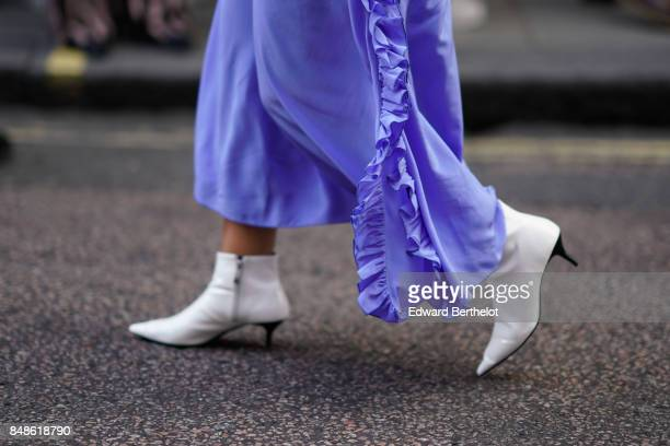 white shoes are seen outside Topshop during London Fashion Week September 2017 on September 17 2017 in London England