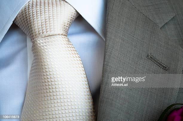 White silk tie with grey jacket lapel