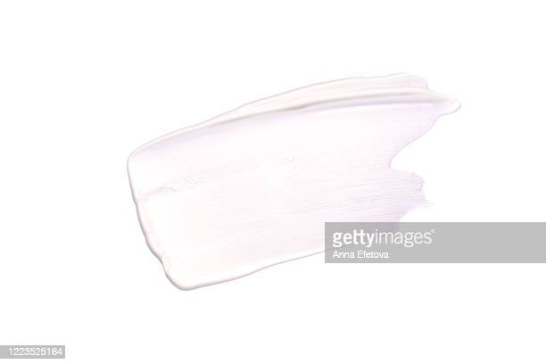 white smear of cream - cream coloured stock pictures, royalty-free photos & images
