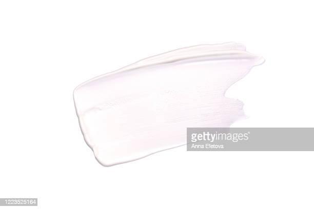 white smear of cream - crèmekleurig stockfoto's en -beelden